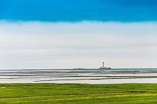 Küstenlandschaft mit Leutturm bei Westerheversand
