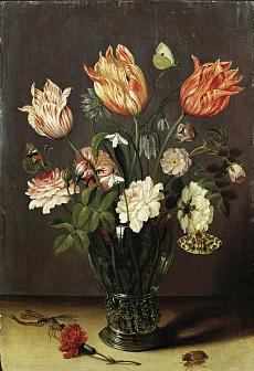 Tulpen und andere Blumen in einem Glas